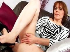 MILF with hairy pussy masturbates