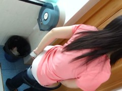 Beautiful Asian baby takes say no to pants off to urinate round a teacher toilet.