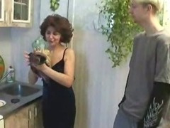 Russian mommy plus young gentleman playing far kitchen