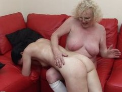 This granny has the younger woman on her knee, but if you are thinking that she is going to lack any sexuality, You have to think again as she lures the younger woman between her legs and spreads her big legs wide open for younger woman. Apparently the black haired woman likes what she finds there.