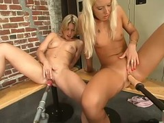 Two slutty blondes play with fucking machines surrounding the locker room
