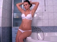 X-rated brunette strips and takes a bath