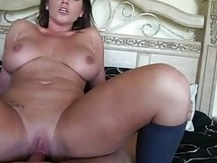 Sensual brunette milf with large balloons rides firm weiner in bedroom